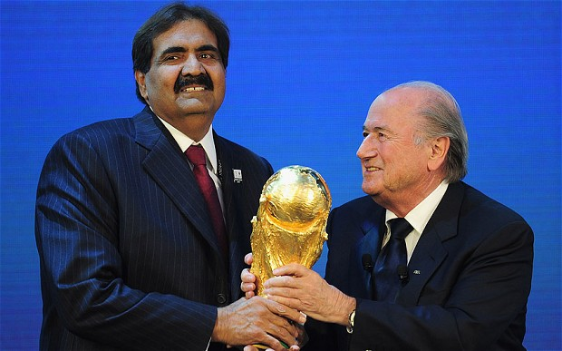 HH Sheikh Hamad bin Khalifa Al Thani of Qatar receives the trophy from FIFA President Joseph S Blatter after the announcement that Qatar had won the bid for the 2022 FIFA World Cup Photo: FIFA/GETTY
