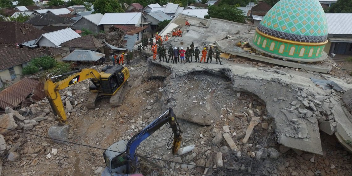 An aerial view of the collapsed Jamiul Jamaah mosque where rescue workers and soldiers search for earthquake victims in Pemenang, North Lombok, Indonesia August 8, 2018 in this photo taken by Antara Foto. Antara Foto/Zabur Karuru/ via REUTERS