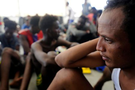 A migrant rests after being rescued by SOS Mediterranee organisation and Doctors Without Borders during a search and rescue (SAR) operation with the MV Aquarius rescue ship in the Mediterranean Sea, off the Libyan Coast, August 10, 2018. REUTERS/Guglielmo Mangiapane