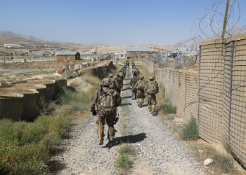 U.S. military advisers from the 1st Security Force Assistance Brigade walk at an Afghan National Army base in Maidan Wardak province, Afghanistan August 6, 2018. REUTERS/James Mackenzie