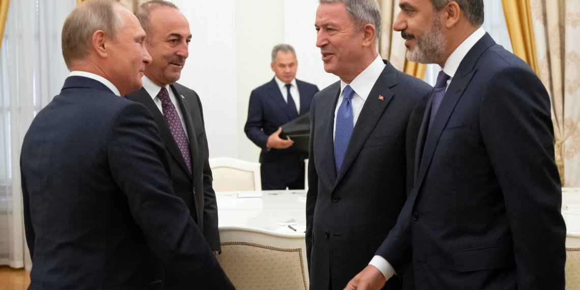 Russian President Vladimir Putin meets Turkish Foreign Minister Mevlut Cavusoglu, Defense Minister Hulusi Akar and intelligence chief Hakan Fidan in the Kremlin in Moscow, Russia August 24, 2018. Alexander Zemlianichenko/Pool via REUTERS