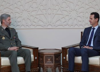 Syrian President Bashar al Assad meets with Iranian Defence Minister Amir Hatami in Damascus,Syria in this handout picture provided by Syrian Arab News Agency on August 26, 2018. SANA/Handout via REUTERS