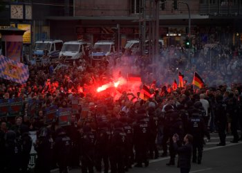 Right-wing supporters protest after a German man was stabbed last weekend in Chemnitz, Germany, August 27, 2018. REUTERS/Matthias Rietschel