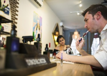 FILE PHOTO: A customer tries different e-cigarette flavors at the Henley Vaporium in New York, U.S. June 23, 2015. REUTERS/Lucas Jackson/File Photo