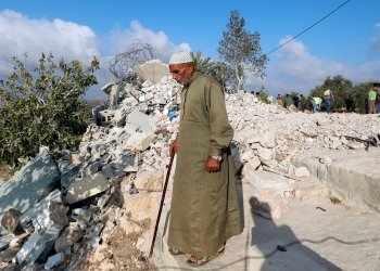 A man walks past the rubble of the family house of Palestinian assailant Mohammed Youssef after it was demolished by Israeli troops in the village of Kobar near Ramallah, in the occupied West Bank August 28, 2018. REUTERS/Mohamad Torokman