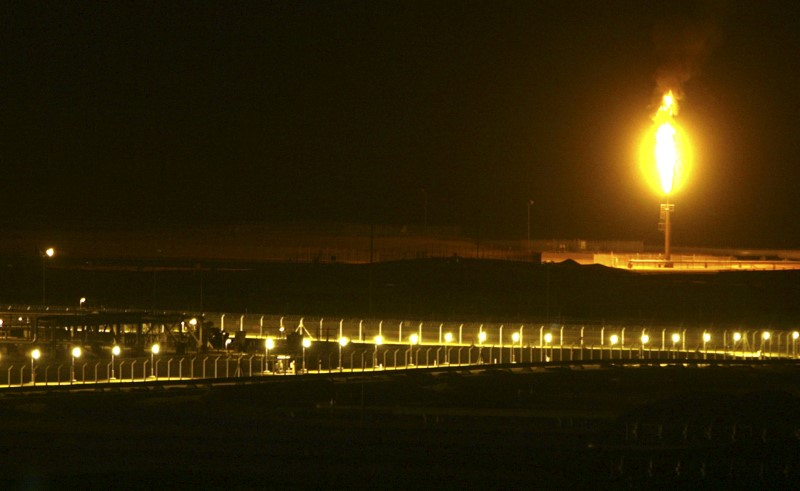 FILE PHOTO: Shaybah oilfield complex is seen at night in the Rub' al-Khali desert, Saudi Arabia, November 14, 2007. REUTERS/Ali Jarekji/File Photo