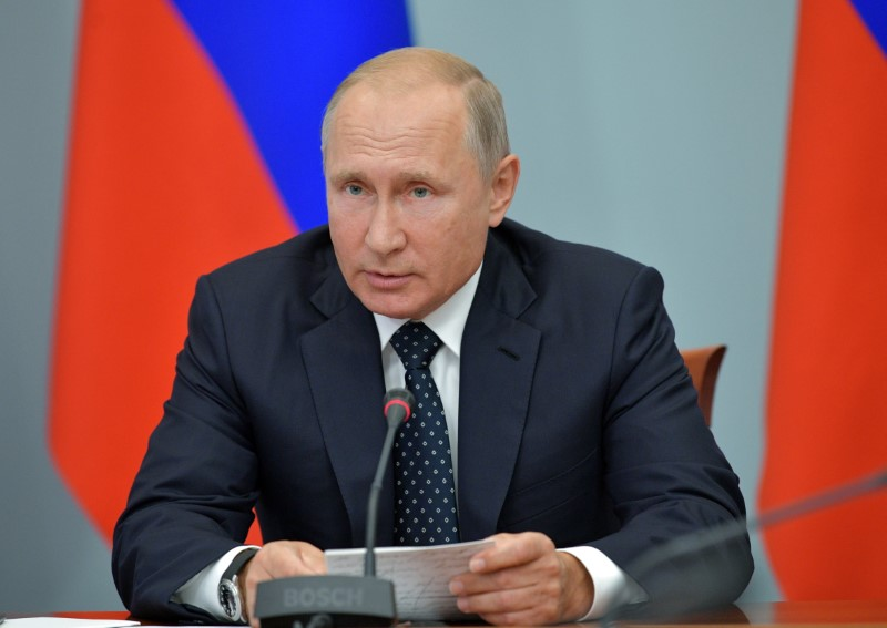 FILE PHOTO: Russia's President Vladimir Putin chairs a government meeting on social and economic issues, including the pension system, in the Siberian city of Omsk, Russia August 28, 2018. Sputnik/Alexei Druzhinin/Kremlin via REUTERS/File Photo
