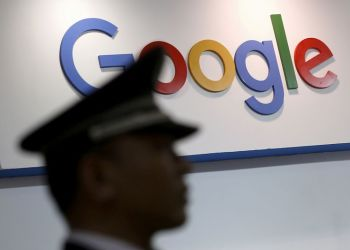 FILE PHOTO: A security guard keeps watch as he walks past a logo of Google in Shanghai, China, April 21, 2016. REUTERS/Aly Song/File Photo