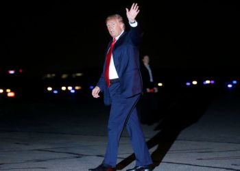 U.S. President Donald Trump waves after exiting Air Force One to board Marine One after returning from Ohio on his way to Bedminster, NJ, at the Morristown Airport in Morristown, NJ, U.S., August 4, 2018. REUTERS/Leah Millis