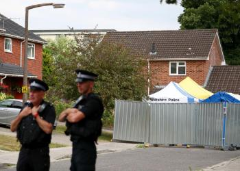 FILE PHOTO - Police officers stand on duty outside Sergei Skripal's home in Salisbury, Britain, July 19, 2018. REUTERS/Hannah McKay