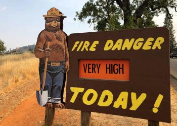 A sign by the side of the road warns of the threat of wildfires which have been fueled by continued hot weather outside the town of Colfax, California, U.S., August 4, 2018. REUTERS/Jim Christie