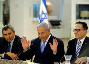 FILE PHOTO: Israeli Prime Minister Benjamin Netanyahu (C), Minister of Jerusalem and Environmental Protection Zeev Elkin (L) and Cabinet Secretary Tzachi Braverman (R) attend a special cabinet meeting marking Jerusalem Day, at the Bible Lands Museum in Jerusalem May 13, 2018. REUTERS/Amir Cohen/Pool/File Photo