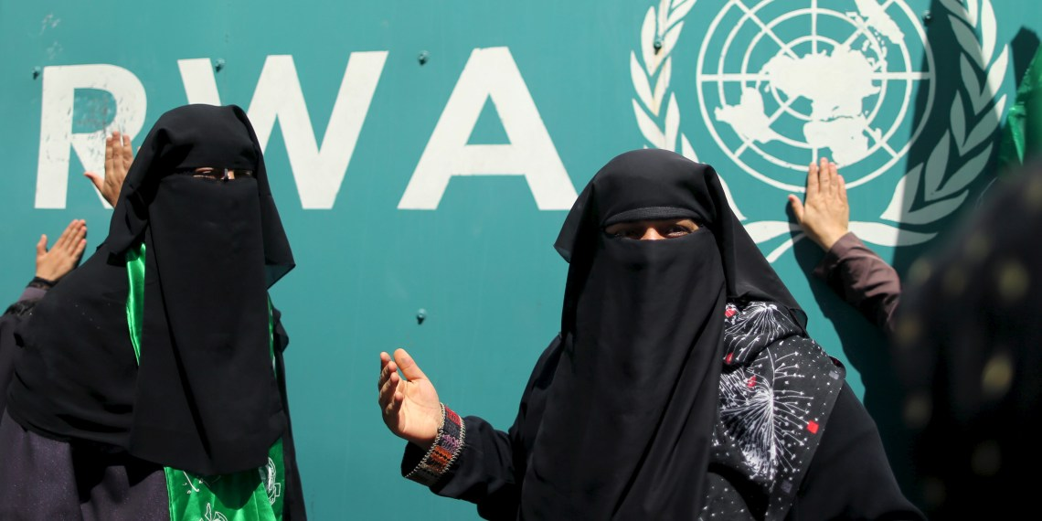FILE PHOTO: Palestinian women take part in a protest against possible reductions of the services and aid offered by United Nations Relief and Works Agency (UNRWA), in front of UNRWA headquarters in Gaza City August 16, 2015. REUTERS/Mohammed Salem