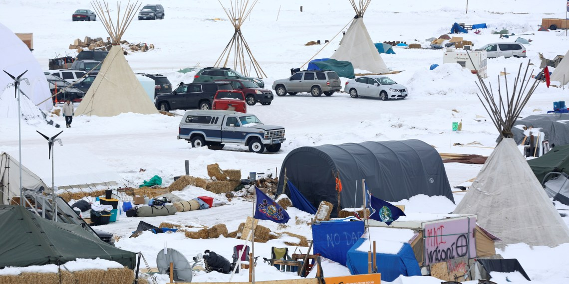 FILE PHOTO: Signs hang in the Dakota Access Pipeline protest camp on the edge of the Standing Rock Sioux Reservation near Cannon Ball, North Dakota, U.S., January 24, 2017. REUTERS/Terray Sylvester/File Photo