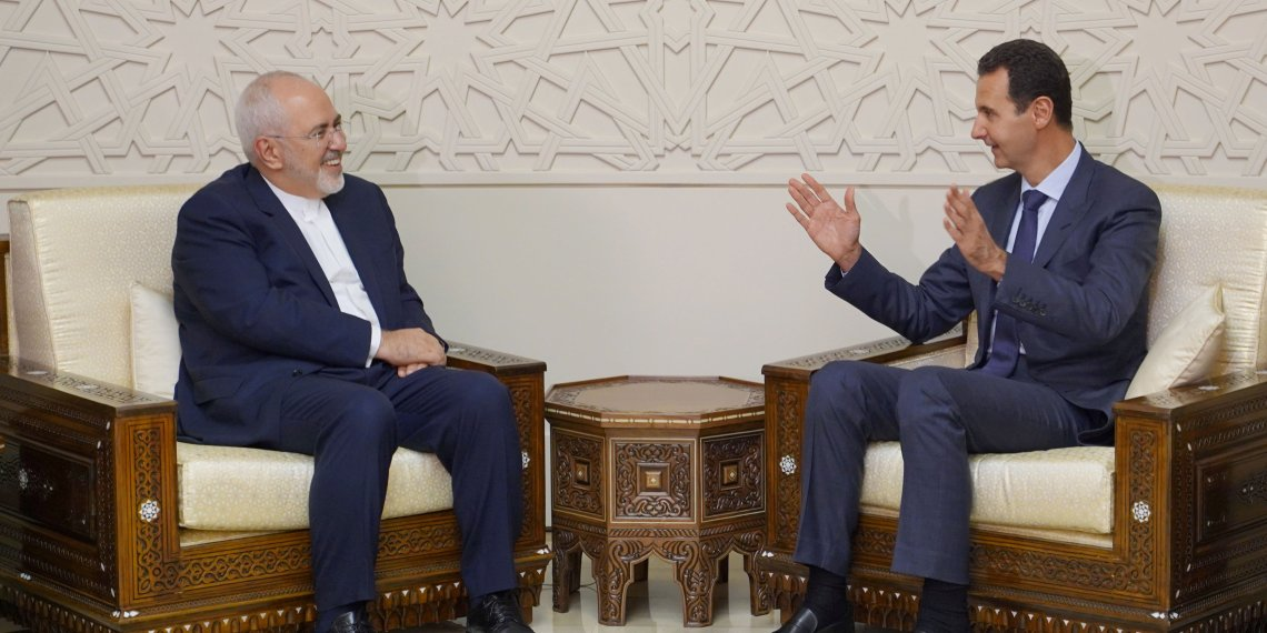 Syrian President Bashar al-Assad meets with Iran's Foreign Minister Mohammad Javad Zarif in Damascus, Syria September 3, 2018. SANA/Handout via REUTERS