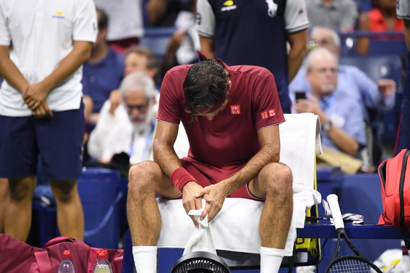 Sep 3, 2018; New York, NY, USA; Roger Federer of Switzerland reacts during a changeover in a fourth round match against John Millman of Australia on day eight of the 2018 U.S. Open tennis tournament at USTA Billie Jean King National Tennis Center.  Danielle Parhizkaran-USA TODAY Sports