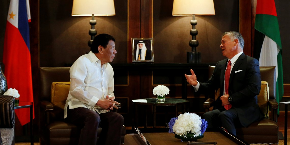 Jordan's King Abdullah gestures as he meets with Philippine President Rodrigo Duterte at the Royal Palace in Amman, Jordan, September 6, 2018. REUTERS/Muhammad Hamed