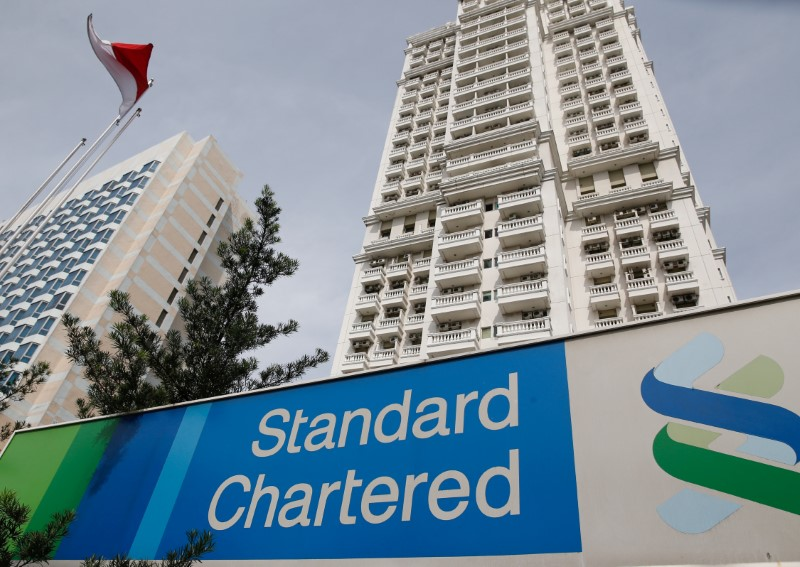 FILE PHOTO: A Standard Chartered sign is seen outside of a building, with a branch of the bank, in Jakarta, Indonesia September 28, 2016. REUTERS/Darren Whiteside/File Photo