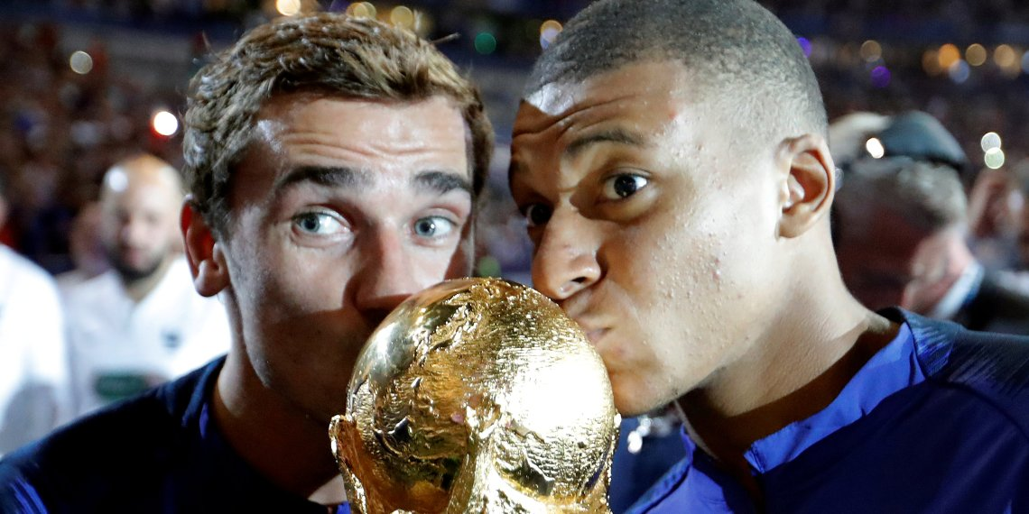 FILE PHOTO: France's Kylian Mbappe and Antoine Griezmann celebrate with the World Cup trophy at Stade de France, Saint-Denis, France - September 9, 2018.  REUTERS/Charles Platiau/File Photo