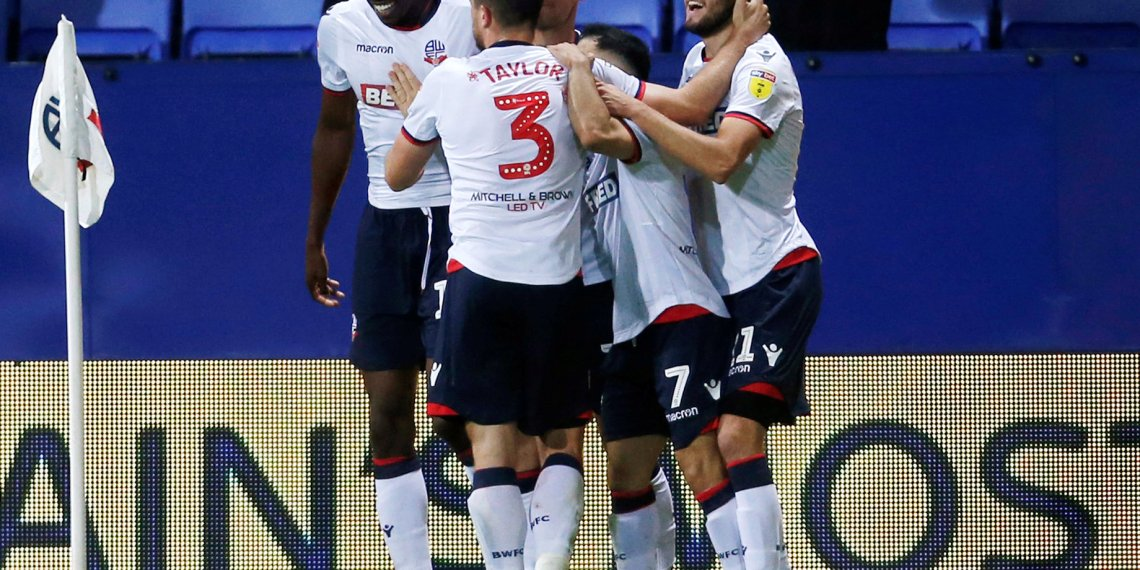 FILE PHOTO: Soccer Football - Championship - Bolton Wanderers v Birmingham City - University of Bolton Stadium, Bolton, Britain - August 22, 2018  Bolton Wanderers' Will Buckley celebrates scoring their first goal with team mates   Action Images/Ed Sykes