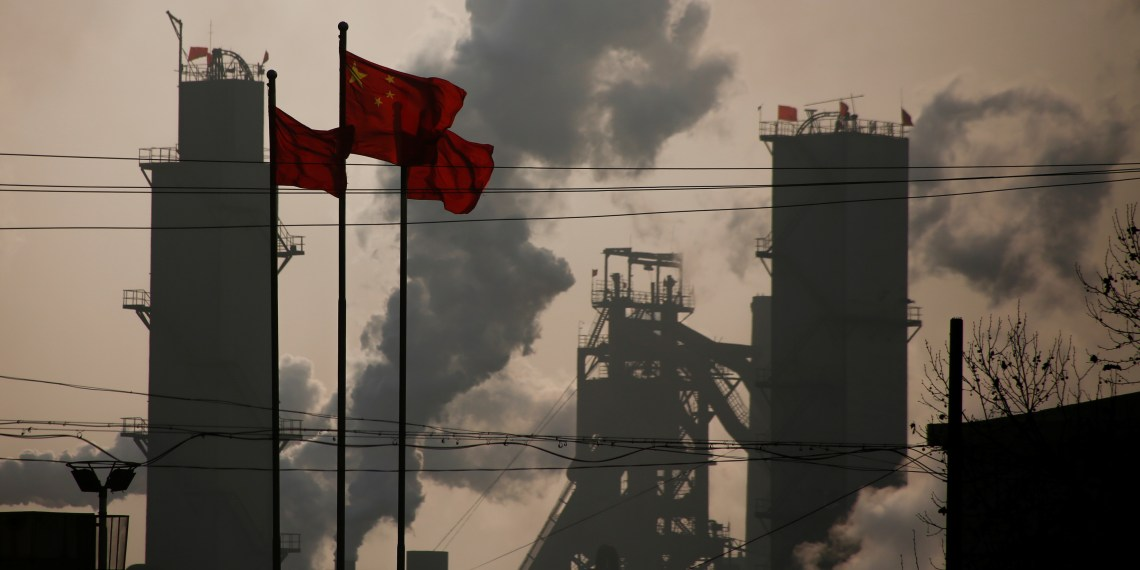 Chinese national flags are flying near a steel factory in Wu'an, Hebei province, China, February 23, 2017. REUTERS/Thomas Peter