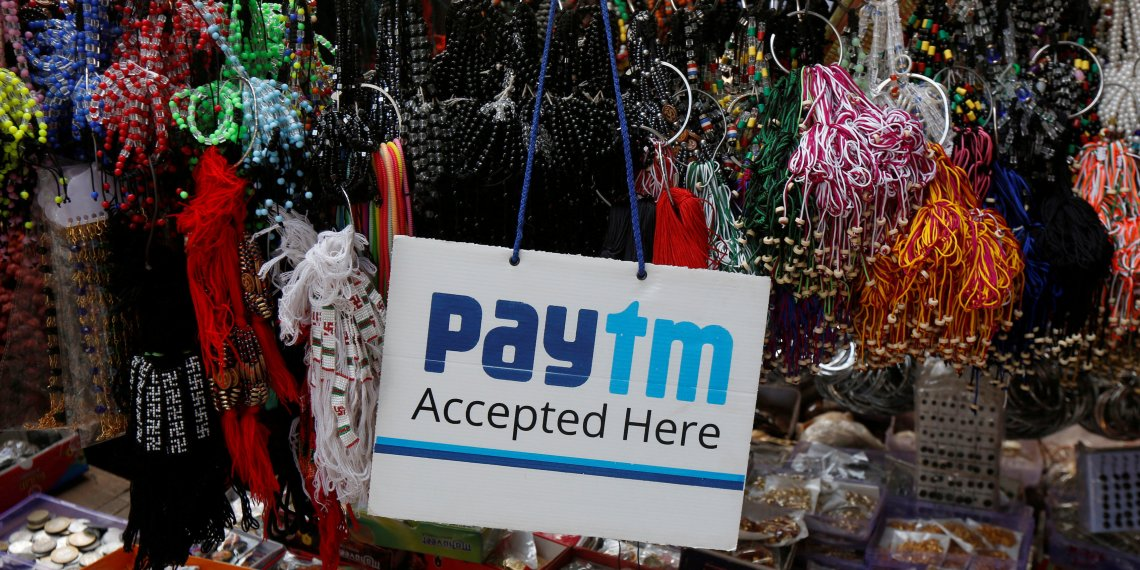 FILE PHOTO: An advertisement of Paytm, a digital wallet company, is pictured at a road side stall in Kolkata, India, January 25, 2017. REUTERS/Rupak De Chowdhuri/File Photo