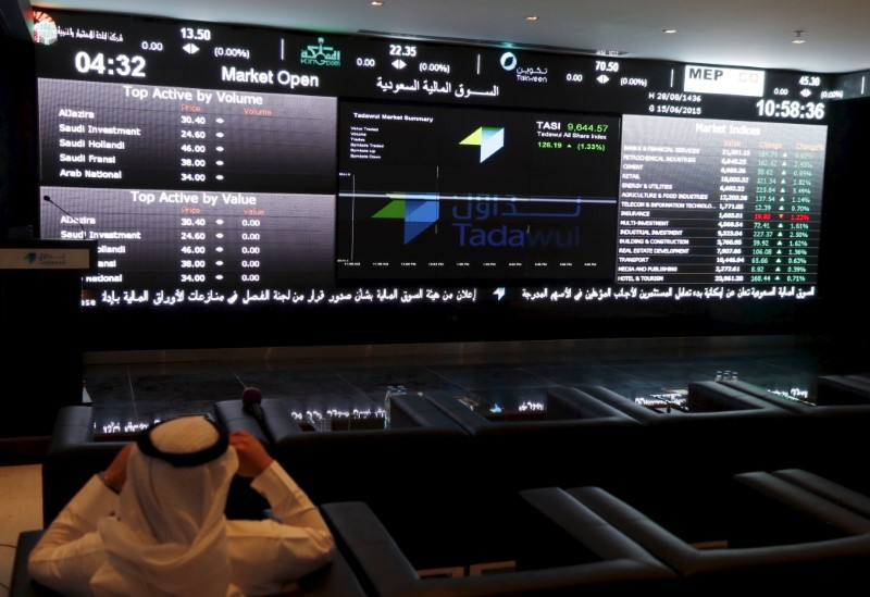 FILE PHOTO - A trader monitors screens displaying stock information at the Saudi Stock Exchange (Tadawul) in Riyadh June 15, 2015. REUTERS/Faisal Al Nasser