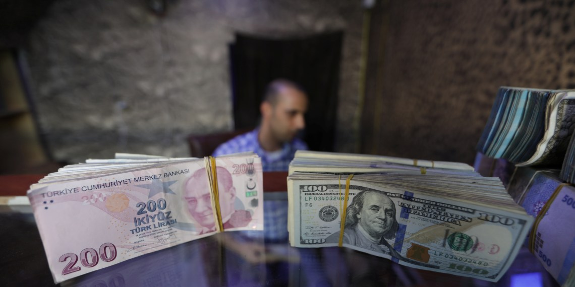 FILE PHOTO - Banknotes of U.S. dollars and Turkish lira are seen in a currency exchange shop in the city of Azaz, Syria August 18, 2018. Picture taken August 18, 2018. REUTERS/Khalil Ashawi