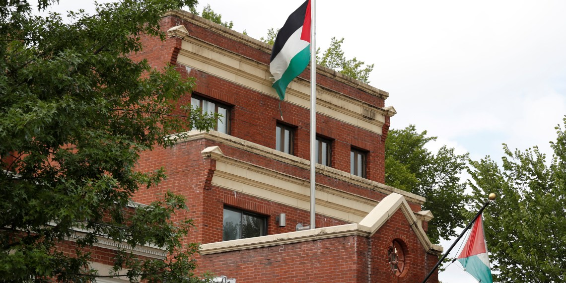 Flags fly over the Palestine Liberation Organization (PLO) office two days after President Donald Trump's national security adviser John Bolton announced that the State Department would close the PLO office in Washington, U.S., September 12, 2018. REUTERS/Kevin Lamarque