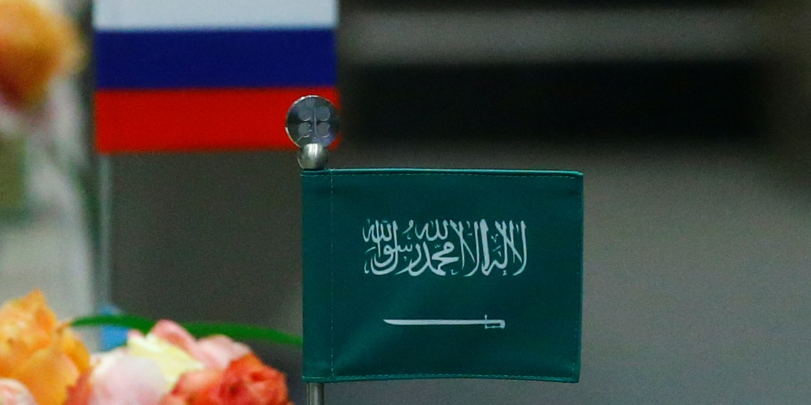 FILE PHOTO: The national flags of Russia and Saudi Arabia are seen during a meeting of the Organization of the Petroleum Exporting Countries (OPEC) and non-OPEC producing countries in Vienna, Austria, May 25, 2017.  REUTERS/Leonhard Foeger
