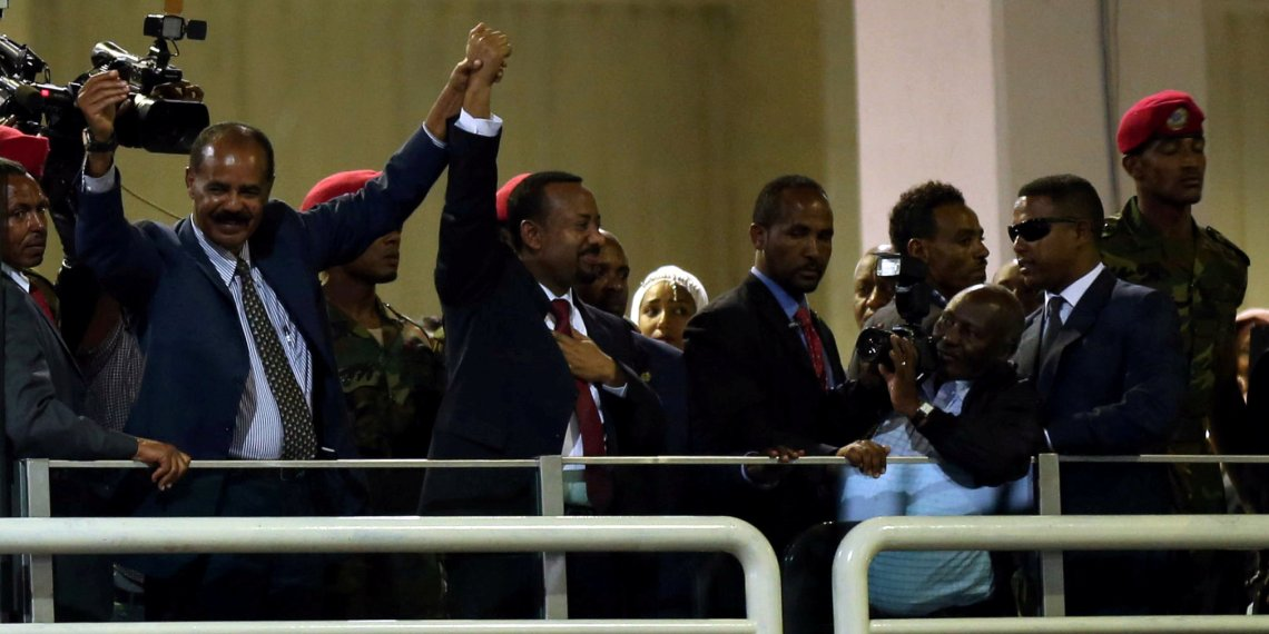 FILE PHOTO: Eritrea's President Isaias Afwerki and Ethiopian Prime Minister Abiy Ahmed hold hands during a concert at the Millennium Hall in Addis Ababa, Ethiopia July 15, 2018. REUTERS/Tiksa Negeri/File Photo
