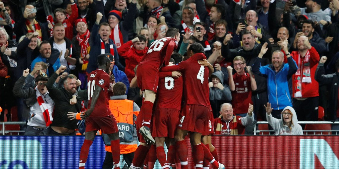 Soccer Football - Champions League - Group Stage - Group C - Liverpool v Paris St Germain - Anfield, Liverpool, Britain - September 18, 2018 Liverpool's Roberto Firmino celebrates scoring their third goal with teammates REUTERS/Phil Noble