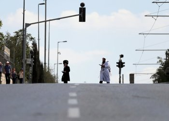 Jewish worshippers walk along an empty street in Jerusalem during the Jewish holiday of Yom Kippur, September 19, 2018. Most Israeli Jews refrain from driving during the 25-hour holy period. REUTERS/Ammar Awad