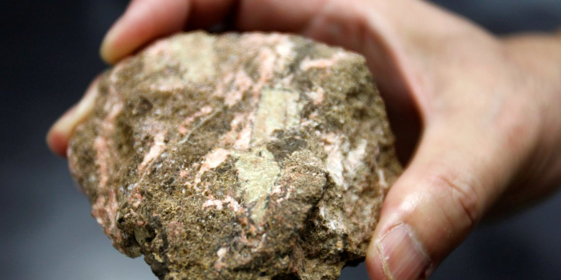 FILE PHOTO: A bastnaesite mineral containing rare earth is pictured at a laboratory of Yasuhiro Kato, an associate professor of earth science at the University of Tokyo, July 5, 2011. REUTERS/Yuriko Nakao/File Photo