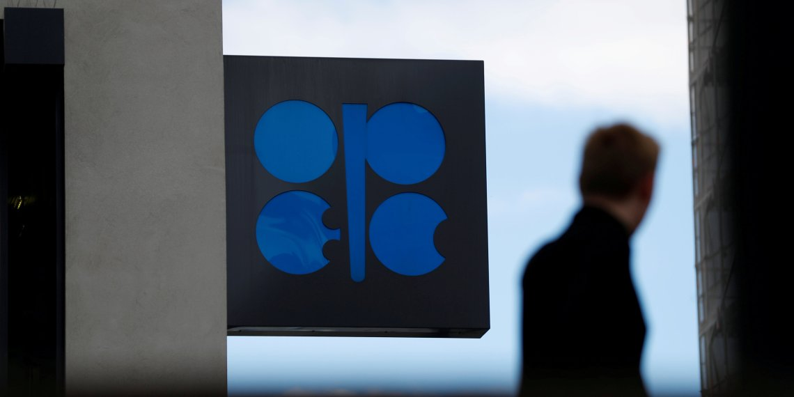 FILE PHOTO: A person passes the logo of the Organization of the Petroleoum Exporting Countries in front of OPEC's headquarters in Vienna, Austria June 19, 2018. REUTERS/Leonhard Foeger