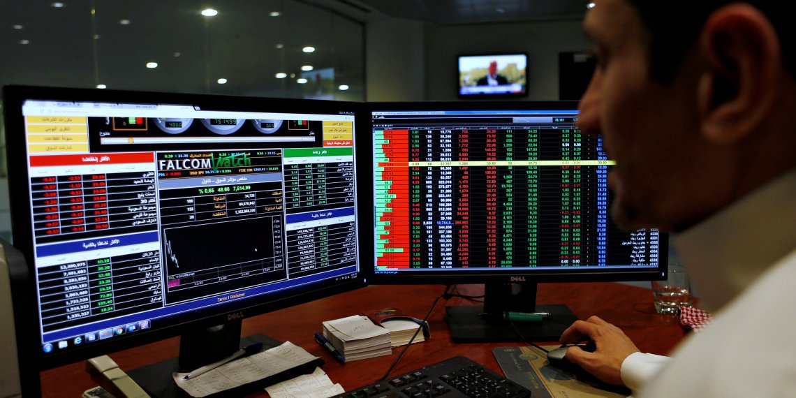 FILE PHOTO: A Saudi trader observes the stock market on monitors at Falcom stock exchange agency in Riyadh, Saudi Arabia February 7, 2018. REUTERS/Faisal Al Nasser/File Photo