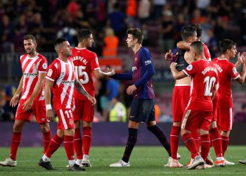Soccer Football - La Liga Santander - FC Barcelona v Girona - Camp Nou, Barcelona, Spain - September 23, 2018 Girona's Juanpe shakes hands with Barcelona's Gerard Pique after the match REUTERS/Albert Gea