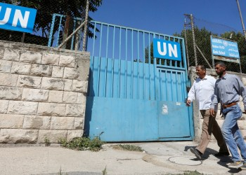 FILE PHOTO: Palestinians pass by the gate of an UNRWA-run school in Nablus in the occupied West Bank August 13, 2018. REUTERS/Abed Omar Qusini