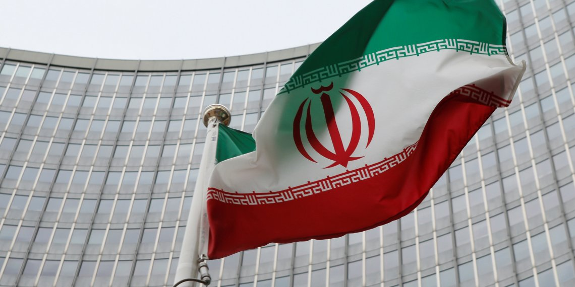 FILE PHOTO: An Iranian flag flutters in front of the International Atomic Energy Agency (IAEA) headquarters in Vienna, Austria, January 15, 2016. REUTERS/Leonhard Foeger/File Photo