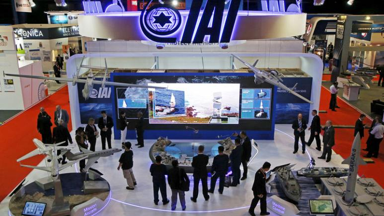 FILE PHOTO - Visitors watch a demonstration at the Israel Aerospace Industries (IAI) booth in the IMDEX Asia maritime defence exhibition in Singapore May 19, 2015. REUTERS/Edgar Su/File Photo