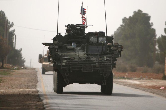 American army vehicles drive north of Manbij city, in Aleppo Governorate, Syria.