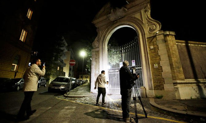 Reporters film the entrance of the Vatican embassy to Italy, Tuesday, Oct. 30, 2018. (AP)
