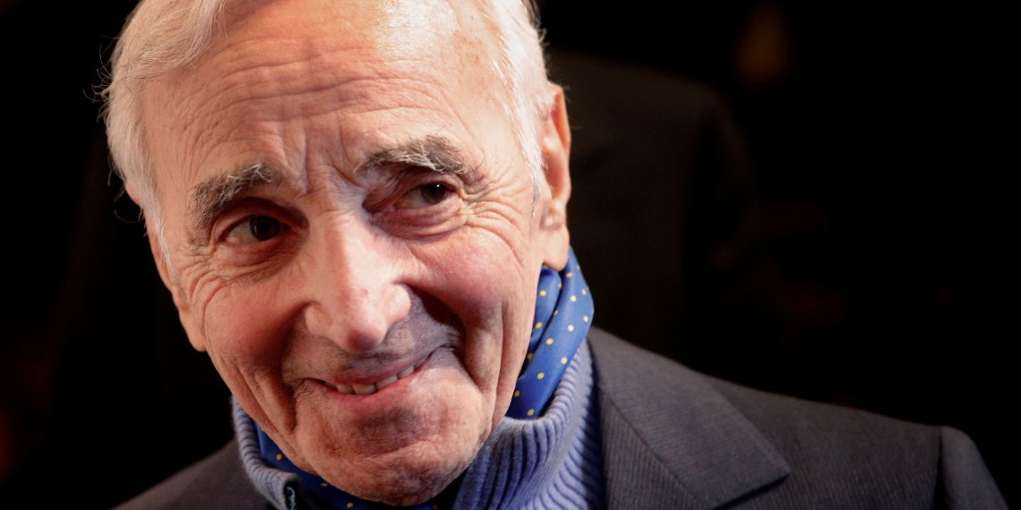 FILE PHOTO: French singer Charles Aznavour attends the annual dinner of CCAF (Co-ordination Council of Armenian organisations of France), in Paris, France, February 8, 2017. REUTERS/Christophe Ena/Pool/File Photo