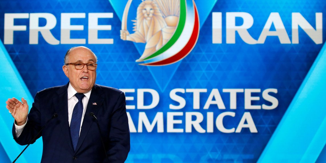 FILE PHOTO: Rudy Giuliani, former Mayor of New York City, delivers his speech as he attends the National Council of Resistance of Iran (NCRI), meeting in Villepinte, near Paris, France, June 30, 2018. REUTERS/Regis Duvignau/File Photo
