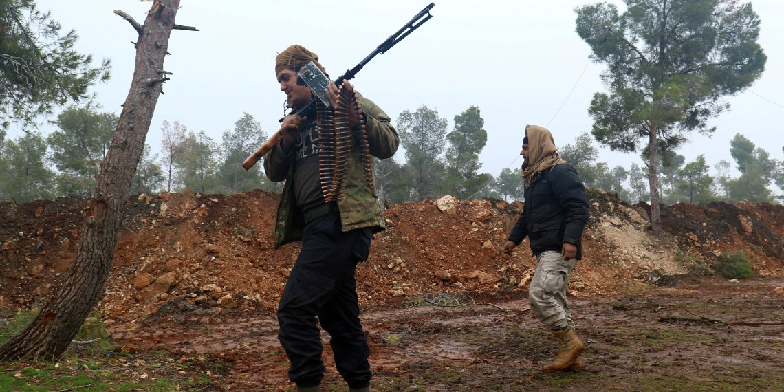 FILE PHOTO:Rebel fighters walk with their weapons at insurgent-held al-Rashideen, Aleppo province, Syria December 30, 2016. REUTERS/Ammar Abdullah/File Photo