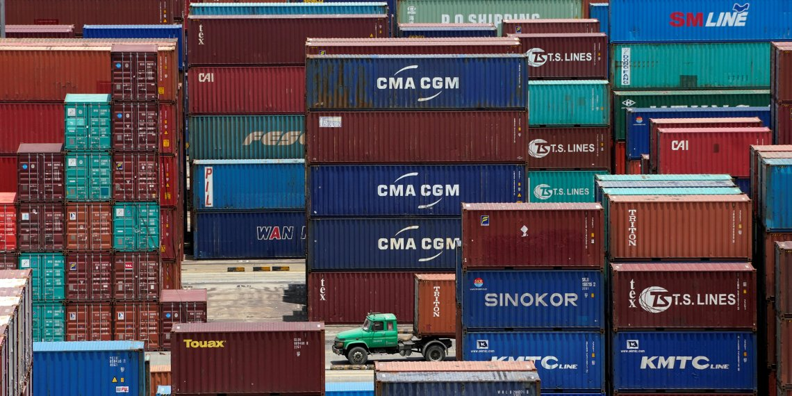 FILE PHOTO: Shipping containers are seen at a port in Shanghai, China July 10, 2018. REUTERS/Aly Song/File Photo