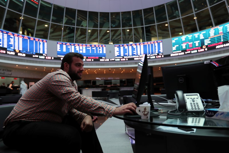 FILE PHOTO: A trader looks at the screens at Bahrain Bourse in Manama, Bahrain, February 7, 2018. REUTERS/Hamad I Mohammed