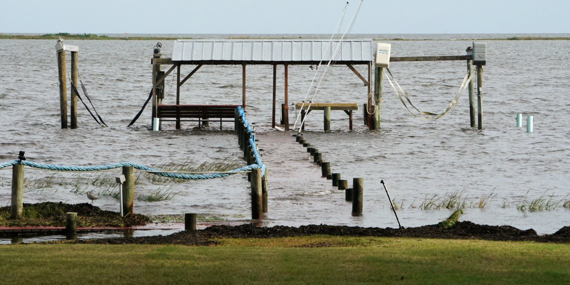 A dock is seen underwater a day before Hurricane Michael comes ashore in Carrabelle, Florida, U.S., October 9, 2018. REUTERS/Carlo Allegri
