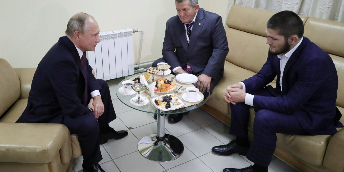 Russian President Vladimir Putin (L) meets with mixed martial arts fighter Khabib Nurmagomedov of Russia (R), UFC lightweight champion who recently defeated Conor McGregor of Ireland in the main event of UFC 229, and his father Abdulmanap Nurmagomedov on the sidelines of a sports forum in Ulyanovsk, Russia October 10, 2018. Sputnik/Mikhail Klimentyev/Kremlin via REUTERS