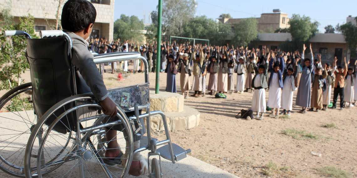 Muhammad al-Shadheli, 9, who survived an August 2018 Saudi-led air strike on a school bus, sits on a wheelchair during the morning drill at his school in Saada province, Yemen October 6, 2018. REUTERS/Naif Rahma